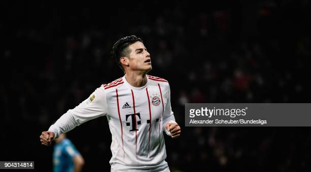 James Rodriguez of Bayern celebrates the third goal for his team during the Bundesliga match between Bayer 04 Leverkusen and FC Bayern Muenchen at...
