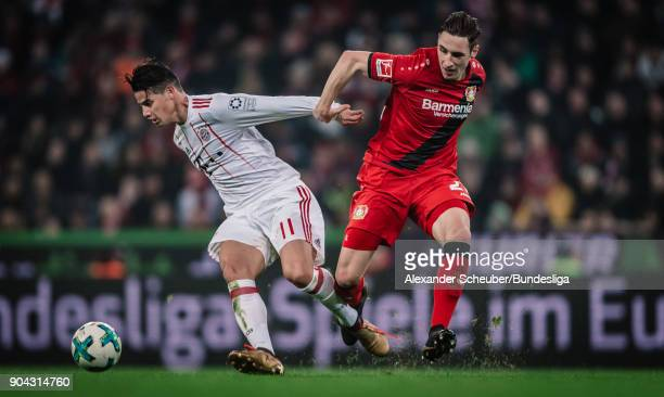 James Rodriguez of Bayern in action against Dominik Kohr of Leverkusen during the Bundesliga match between Bayer 04 Leverkusen and FC Bayern Muenchen...