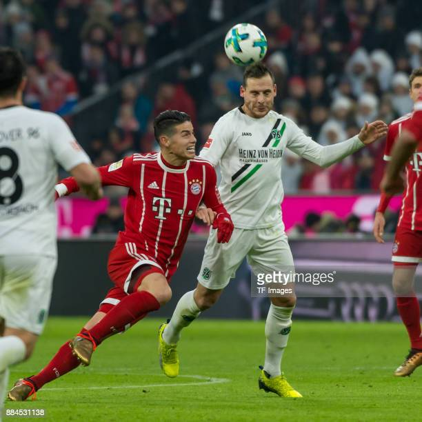 James Rodriguez of Bayern Muenchen and Marvin Bakalorz of Hannover battle for the ball during the Bundesliga match between FC Bayern Muenchen and...