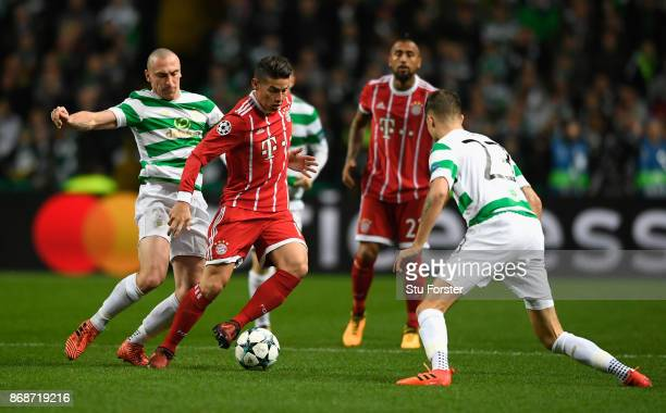James Rodriguez of Bayern Muenchen and Scott Brown of Celtic battle for the ball during the UEFA Champions League group B match between Celtic FC and...