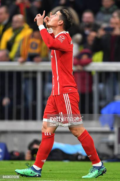 James Rodriguez of Bayern Muenchen celebrates after he scored a goal to make it 20 during the Bundesliga match between FC Bayern Muenchen and...