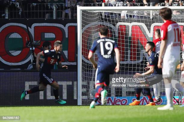 James Rodriguez of Bayern Muenchen celebrates after he scored a goal to m are it 12 during the Bundesliga match between FC Augsburg and FC Bayern...
