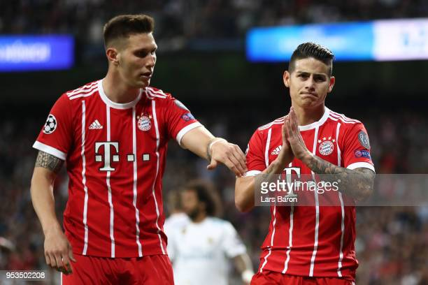 James Rodriguez of Bayern Muenchen celebrates as he scores his sides second goal with Niklas Suele of Bayern Muenchen during the UEFA Champions...