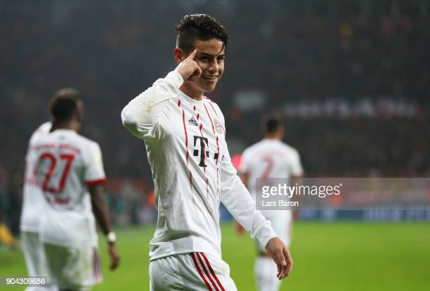 James Rodriguez of Bayern Muenchen celebrates as he scores their third goal from a free kick during the Bundesliga match between Bayer 04 Leverkusen...