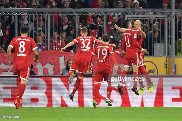 James Rodriguez of Bayern Muenchen celebrates with Arjen Robben of Bayern Muenchen after he scored his teams first goal to make it 10 during the...