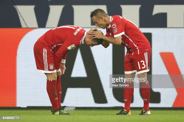 James Rodriguez of Bayern Muenchen celebrates with Rafinha of Bayern Muenchen after he scored his teams second goal to make it 20 during the...
