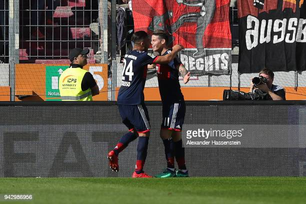 James Rodriguez of Bayern Muenchen celebrates with Tolisso of Bayern Muenchen after he scored a goal to m are it 12 during the Bundesliga match...