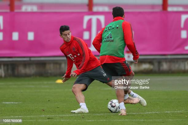James Rodriguez of Bayern Muenchen challenges Mats Hummels of Bayern Muenchen during a training session at Saebener Strasse training ground on...