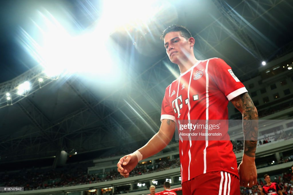 James Rodriguez of Bayern Muenchen enters the field of play for the Audi Football Summit 2017 match between Bayern Muenchen and Arsenal FC at Shanghai Stadium during the Audi Summer Tour 2017 on July 19, 2017 in Shanghai, China.