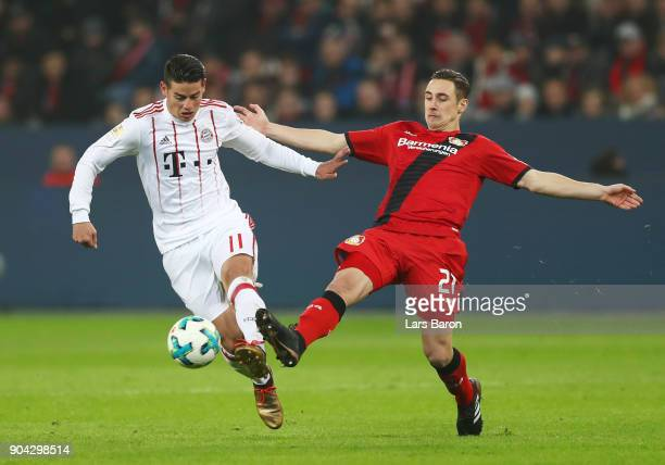 James Rodriguez of Bayern Muenchen evades Dominik Kohr of Bayer Leverkusen during the Bundesliga match between Bayer 04 Leverkusen and FC Bayern...