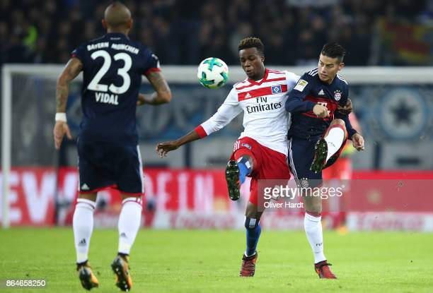 James Rodriguez of Bayern Muenchen fights for the ball with Gideon Jung of Hamburg during the Bundesliga match between Hamburger SV and FC Bayern...