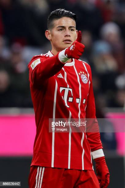 James Rodriguez of Bayern Muenchen gestures during the Bundesliga match between FC Bayern Muenchen and Hannover 96 at Allianz Arena on December 2...