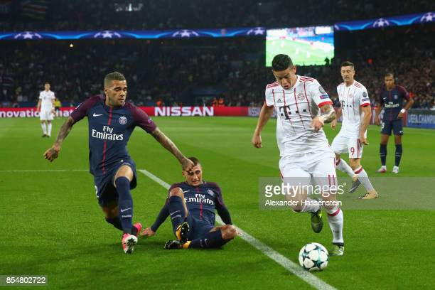 James Rodriguez of Bayern Muenchen is closed down by Dani Alves of PSG during the UEFA Champions League group B match between Paris SaintGermain and...