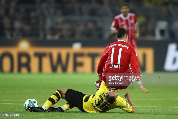 James Rodriguez of Bayern Muenchen is fouled by Oemer Toprak of Dortmund during the Bundesliga match between Borussia Dortmund and FC Bayern Muenchen...