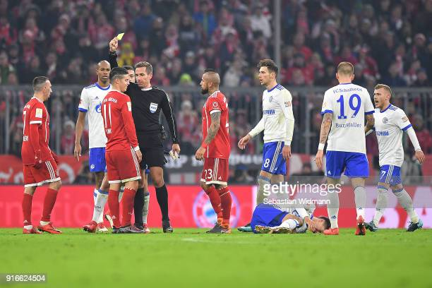 James Rodriguez of Bayern Muenchen is shown a yellow card by referee Tobias Stieler during the Bundesliga match between FC Bayern Muenchen and FC...