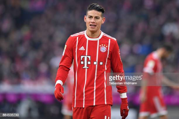 James Rodriguez of Bayern Muenchen looks on during the Bundesliga match between FC Bayern Muenchen and Hannover 96 at Allianz Arena on December 2...