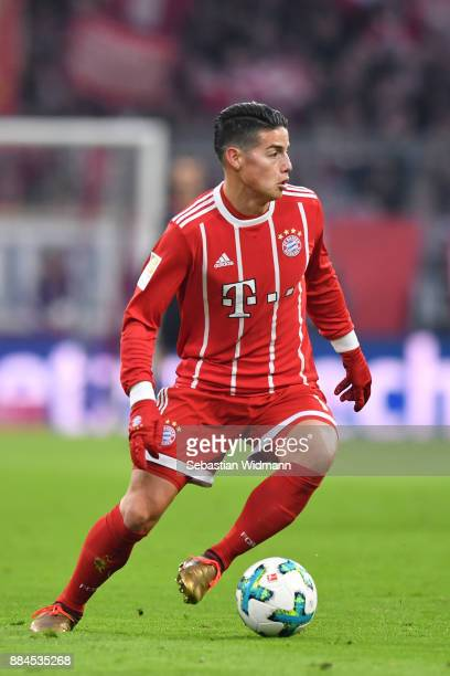 James Rodriguez of Bayern Muenchen plays the ball during the Bundesliga match between FC Bayern Muenchen and Hannover 96 at Allianz Arena on December...