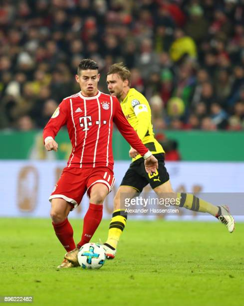James Rodriguez of Bayern Muenchen runs with the ball during the DFB Cup match between Bayern Muenchen and Borussia Dortmund at Allianz Arena on...