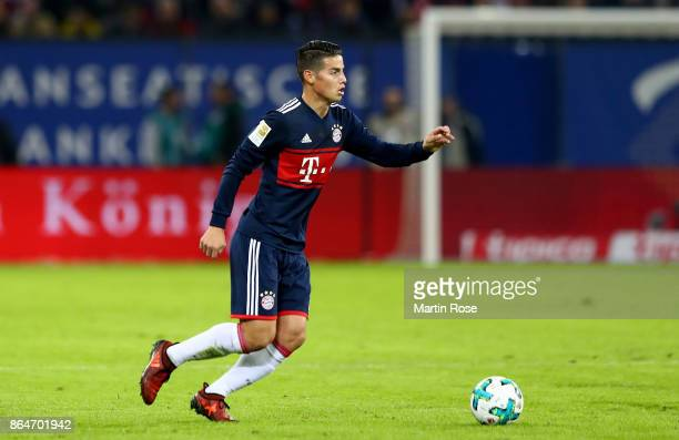 James Rodriguez of Bayern Muenchen runs with the ball during the Bundesliga match between Hamburger SV and FC Bayern Muenchen at Volksparkstadion on...