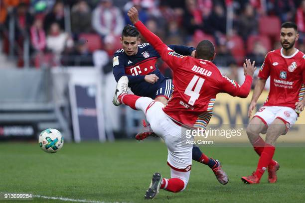James Rodriguez of Bayern Muenchen scores a goal to make it 20 during the Bundesliga match between 1 FSV Mainz 05 and FC Bayern Muenchen at Opel...