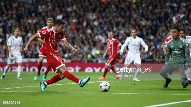 James Rodriguez of Bayern Muenchen scores his sides second goal past Keylor Navas of Real Madrid during the UEFA Champions League Semi Final Second...