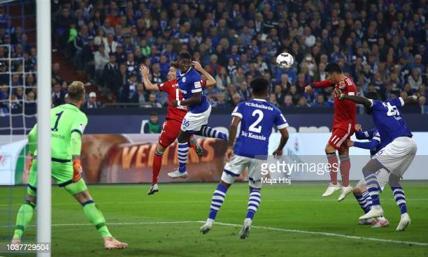 James Rodriguez of Bayern Muenchen scores his team's first goal during the Bundesliga match between FC Schalke 04 and FC Bayern Muenchen at...