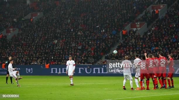 James Rodriguez of Bayern Muenchen scores their third goal from a free kick during the Bundesliga match between Bayer 04 Leverkusen and FC Bayern...
