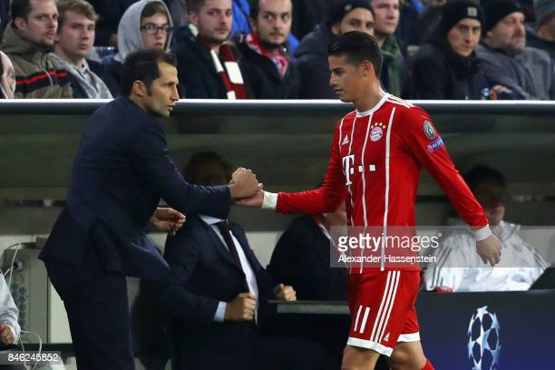 James Rodriguez of Bayern Muenchen shake hands with his sport director Hasan Salihamidzic during the UEFA Champions League group B match between FC...