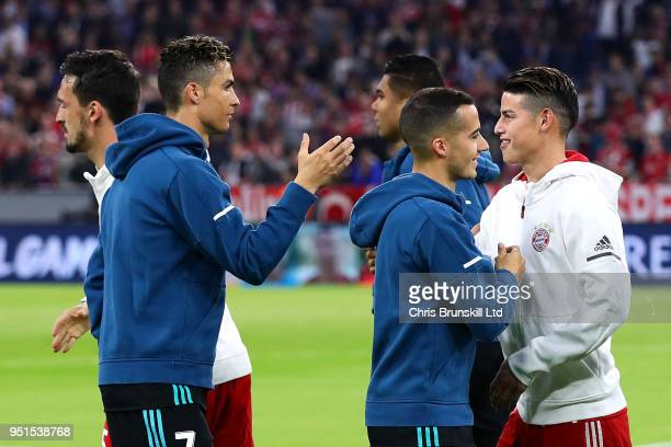 James Rodriguez of Bayern Muenchen shakes hands with Cristiano Ronaldo of Real Madrid ahead of the UEFA Champions League Semi Final First Leg match...