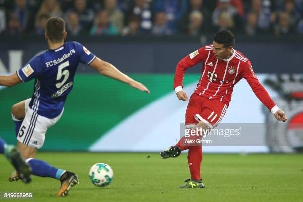 James Rodriguez of Bayern Muenchen shoots to score his teams second goal to make it 20 during the Bundesliga match between FC Schalke 04 and FC...