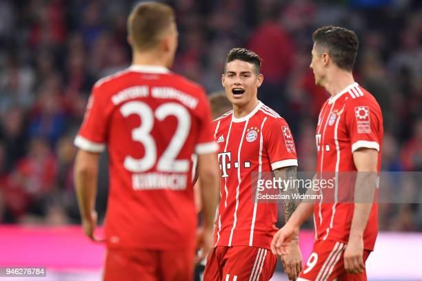 James Rodriguez of Bayern Muenchen talks to Robert Lewandowski and Joshua Kimmich of Bayern Muenchen during the Bundesliga match between FC Bayern...
