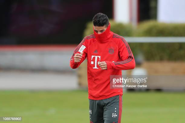 James Rodriguez of Bayern Muenchen wears a mask over his face during a training session at Saebener Strasse training ground on October 31 2018 in...