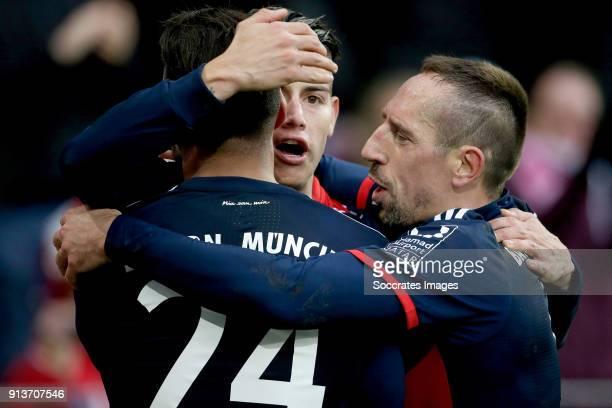 James Rodriguez of Bayern Munchen celebrates 02 with Corentin Tolisso of Bayern Munchen Franck Ribery of Bayern Munchen during the German Bundesliga...