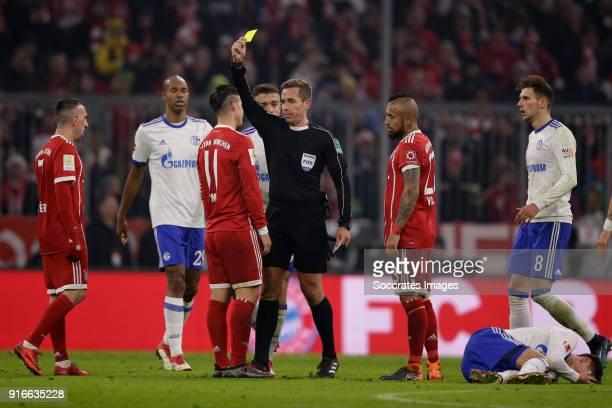 James Rodriguez of Bayern Munchen receives a yellow card from referee Tobias Stieler during the German Bundesliga match between Bayern Munchen v...