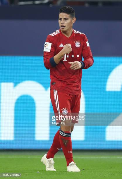James Rodriguez of Bayern Munich celebrates after scoring his team's first goal during the Bundesliga match between FC Schalke 04 and FC Bayern...
