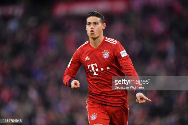 James Rodriguez of Bayern Munich celebrates after scoring his team's third goal during the Bundesliga match between FC Bayern Muenchen and VfL...