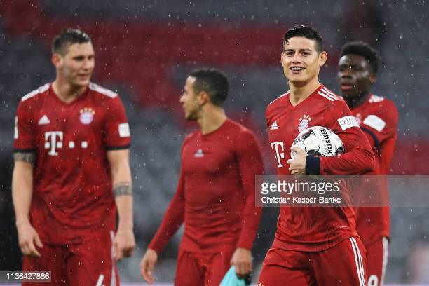 James Rodriguez of Bayern Munich celebrates after the match with the ball for scoring a hattrick during the Bundesliga match between FC Bayern...