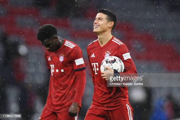 James Rodriguez of Bayern Munich celebrates after the match with the ball for scoring a hattrick 1 during the Bundesliga match between FC Bayern...