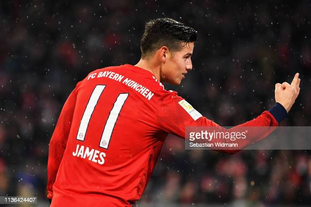 James Rodriguez of Bayern Munich celebrates his hattrick by holding three fingers up during the Bundesliga match between FC Bayern Muenchen and 1 FSV...