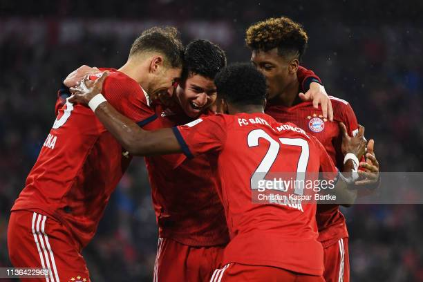 James Rodriguez of Bayern Munich celebrates scoring his teams fourth goal with Leon Goretzka David Alaba and Kingsley Coman during the Bundesliga...
