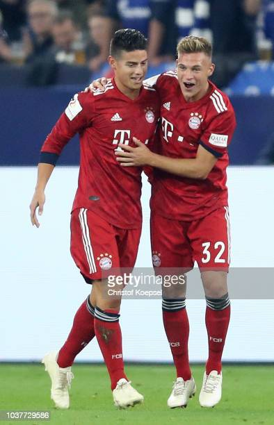James Rodriguez of Bayern Munich celebrates with teammate Joshua Kimmich after scoring his team's first goal during the Bundesliga match between FC...