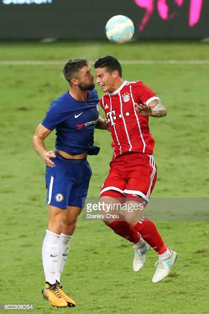 James Rodriguez of Bayern Munich clashes with Gary Cahill of Chelsea during the International Champions Cup match between Chelsea FC and FC Bayern...
