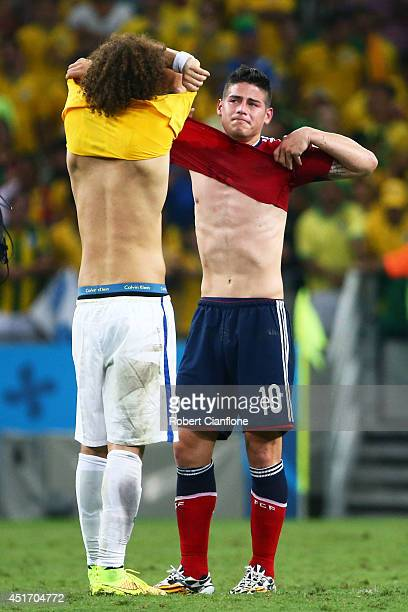 James Rodriguez of Colombia and David Luiz of Brazil exchange jerseys after Brazil's 21 win during the 2014 FIFA World Cup Brazil Quarter Final match...