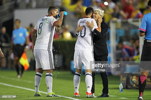 James Rodriguez of Colombia and his coach Jose Pekerman hug during a group A match between Colombia and Paraguay at Rose Bowl Stadium as part of Copa...