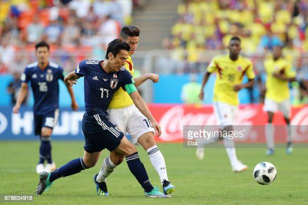 James Rodriguez of Colombia and Makoto Hasebe of Japan in action during the 2018 FIFA World Cup Russia group H match between Colombia and Japan at...