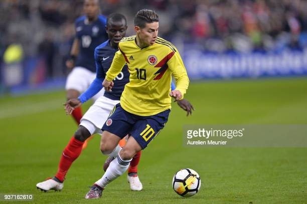 James Rodriguez of Colombia and N Golo Kante of France fight for the ball during the international friendly match between France and Colombia at...