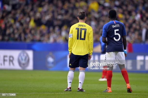 James Rodriguez of Colombia and Samuel Umtiti of France react during the international friendly match between France and Colombia at Stade de France...