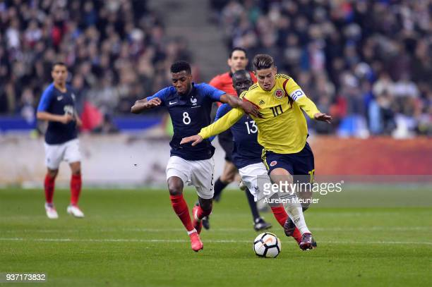 James Rodriguez of Colombia and Thomas Lemar and N Golo Kante of France fight for the ball during the international friendly match between France and...