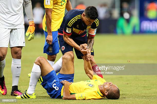 James Rodriguez of Colombia assits Miranda of Brazil during a match between Brazil and Colombia as part of FIFA 2018 World Cup Qualifiers at Arena...