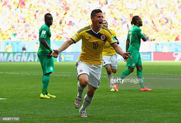James Rodriguez of Colombia celebrates after scoring his team's first goal during the 2014 FIFA World Cup Brazil Group C match between Colombia and...